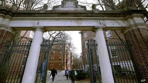 FILE - In this Dec. 13, 2018, file photo, a gate opens to the Harvard University campus in Cambridge, Mass. The U.S. Education…
