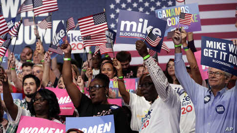 Supporters of Democratic presidential candidate former New York City Mayor Mike Bloomberg attend a primary election night…