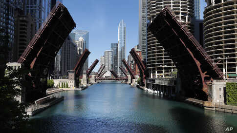 Several street bridges over the Chicago River remain closed early Sunday morning, May 31, 2020 in Chicago, after a night of…