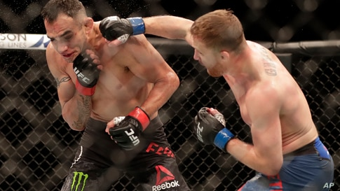 Justin Gaethje, right, punches Tony Ferguson during a UFC 249 mixed martial arts bout, Saturday, May 9, 2020, in Jacksonville,…