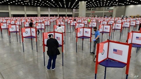 FILE - In this June 23, 2020, file photo voting stations are set up in the South Wing of the Kentucky Exposition Center for…