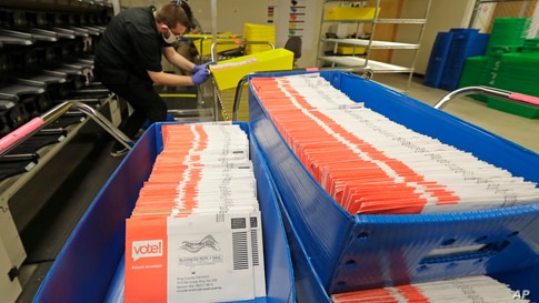 Vote-by-mail ballots are shown in sorting trays, Wednesday, Aug. 5, 2020, at the King County Elections headquarters in Renton,…