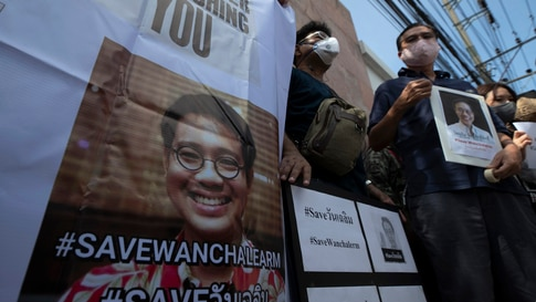 Activists hold photos of Thai dissident Wanchalearm Satsaksit gather for a rally in front of Cambodian Embassy in Bangkok,…