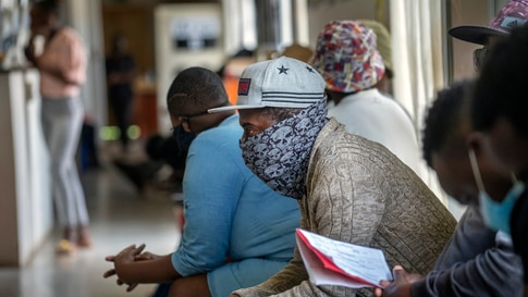 Volunteers wait to be checked at a vaccine trial facility set at Soweto's Chris Sani Baragwanath Hospital outside Johannesburg,…