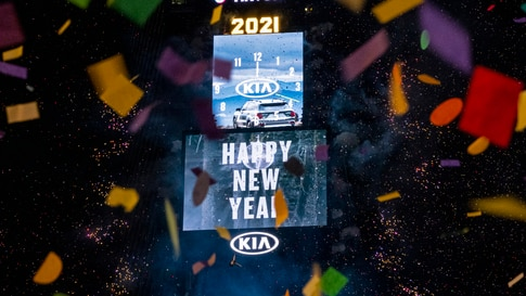 Confetti flies after the Times Square New Year's Eve Ball drops in a nearly empty Times Square, late Thursday, early Friday,…