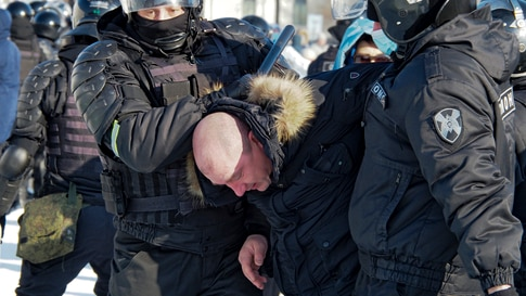 Police detain a man during a protest against the jailing of opposition leader Alexei Navalny in Khabarovsk, 6,100 kilometers (3…
