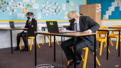 Britain's Prime Minister Boris Johnson takes part in an online class, during a visit to Sedgehill School in Lewisham, south…