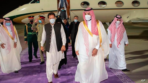 In this photo released by Saudi Royal Palace, Saudi Crown Prince Mohammed bin Salman, right, meets Pakistan's Prime Minister…