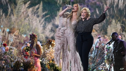 """Jennifer Lopez performs with her mother, Guadalupe Rodríguez, at """"Vax Live: The Concert to Reunite the World"""" on Sunday, May 2,…"""