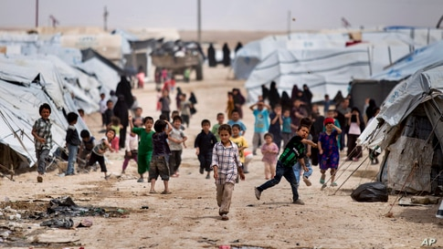 Children gather outside their tents, at al-Hol camp, which houses families of members of the Islamic State group, in Hasakeh…