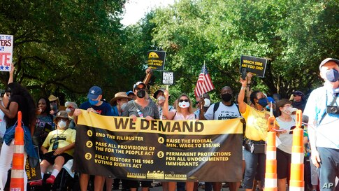 Protesters march for voting rights at the Texas Capitol in Austin, Texas on Saturday, July 31, 2021.  Hundreds of people packed…