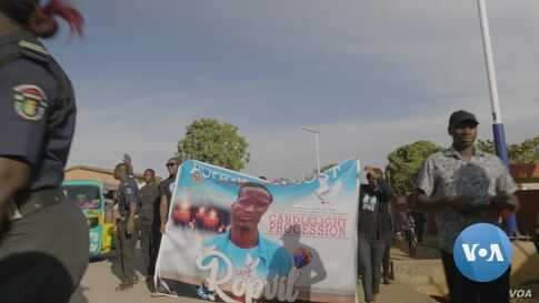 Nigerian Youth Hold Vigil for Student Killed by ISIS Affiliate
