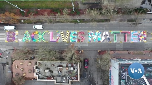 Seattle Struggles with Protest Signage: Art? Or Graffiti?