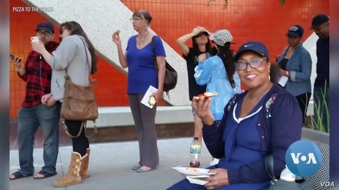 Pizza to the Polls Feeds People Waiting in Lines to Vote