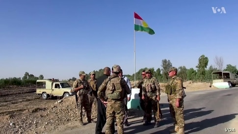 Tensions at Checkpoint Over Flag Impedes Anti-IS Effort in Iraq