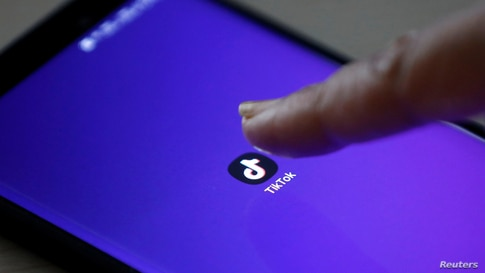 FILE PHOTO: The logo of TikTok application is seen on a mobile phone screen in this picture illustration taken February 21,…