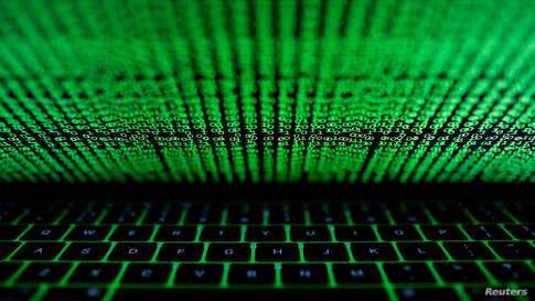 FILE PHOTO: A computer keyboard lit by a displayed cyber code is seen in this illustration picture taken on March 1,  2017…