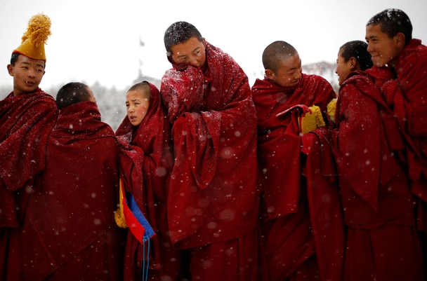 Tibetan monks attend a ceremony at the Langmu Lamasery during the