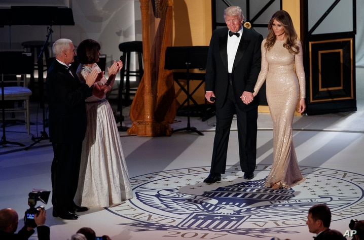 Vice President-elect Mike Pence, left, and his wife Karen, second from left, applaud as President-elect Donald Trump and his wife Melania arrive for a VIP reception and dinner with donors, Jan. 19, 2017.