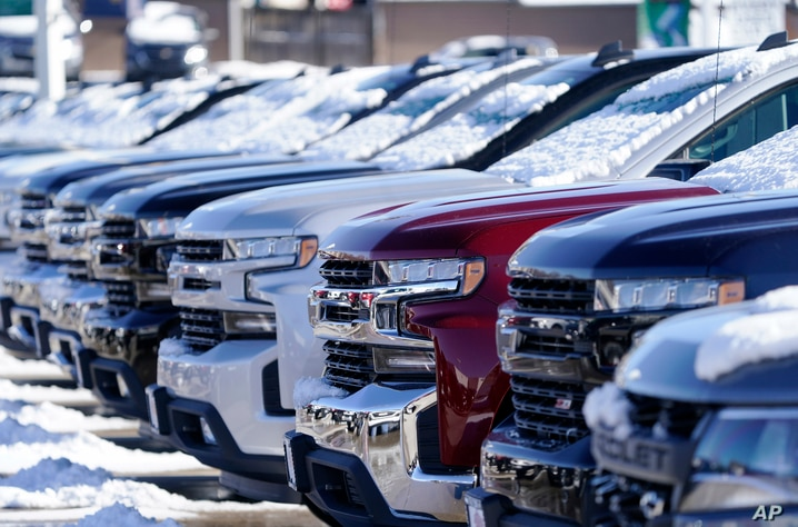 A long line of unsold 2021 Silverado pickup trucks sits at a Chevrolet dealership Sunday, Feb. 21, 2021, in Englewood, Colo. …