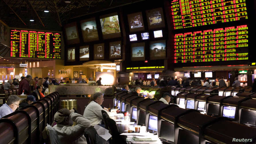 Proposition bets (R) for Super Bowl XLV are posted at the race and sports book in the Las Vegas Hilton in Las Vegas, Nevada January 27, 2011
