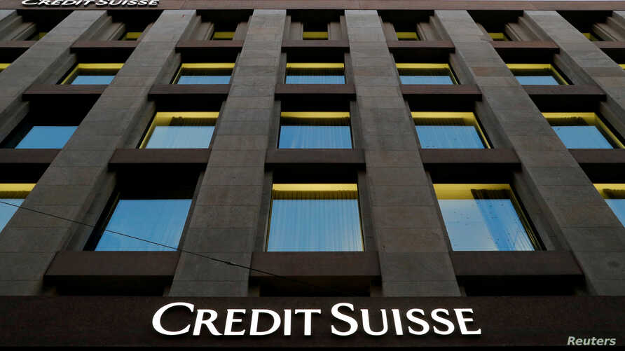 FILE PHOTO: The Credit Suisse logo is pictured on a bank in Geneva, Switzerland, Oct. 17, 2017.