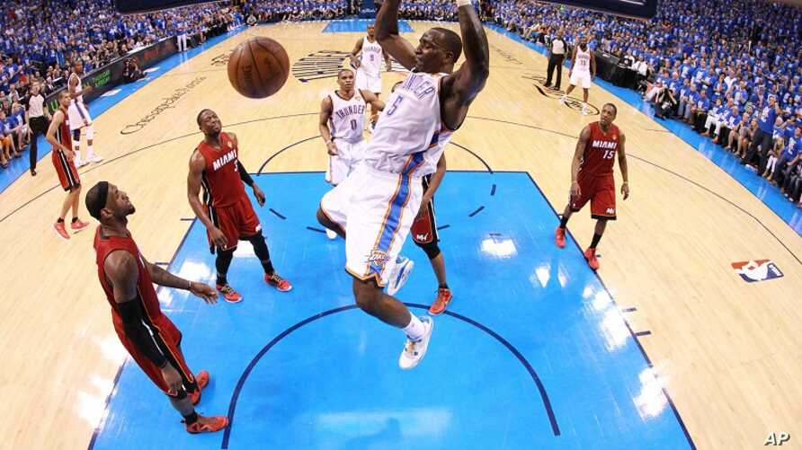 Oklahoma City Thunder center Kendrick Perkins (5) dunks against Miami Heat at Game 1 of the NBA finals basketball series, June 12, 2012, in Oklahoma City.