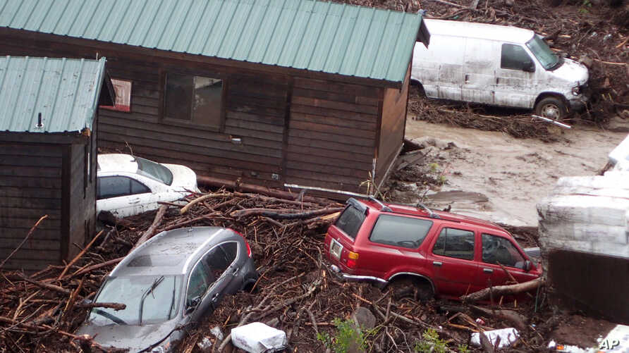 Cabins and vehicles are swept away by storm runoff at El Capitan Canyon Resort & Campground in Gaviota, Calif., Jan. 20, 2017.