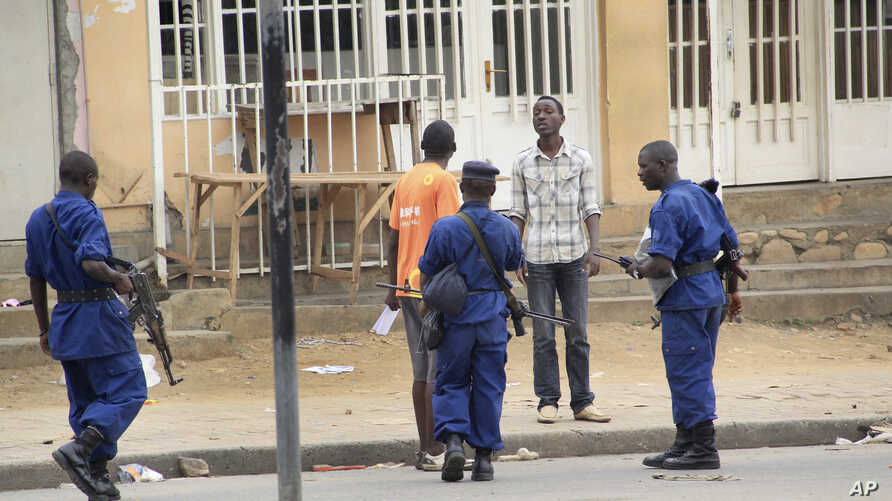 Police arrest a man following grenade attacks in the capital Bujumbura, Burundi Wednesday, Feb. 3, 2016.