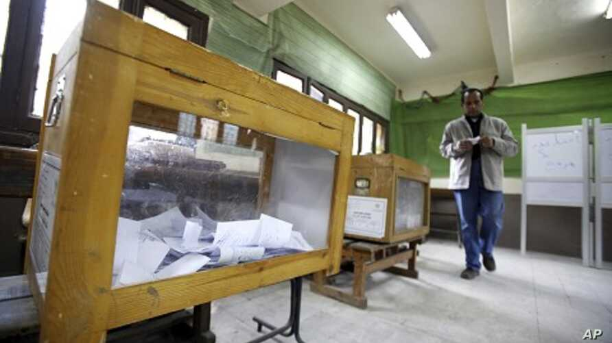 A man prepares to cast his vote during the second day of the parliamentary runoff elections at a polling station in Cairo, December 6, 2011.