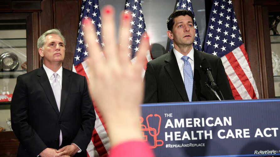 FILE - Speaker of the House Paul Ryan and House Majority Leader Kevin McCarthy  answer questions about the American Health Care Act, the Republican replacement to Obamacare, at the Republican National Committee in Washington, March 8, 2017.