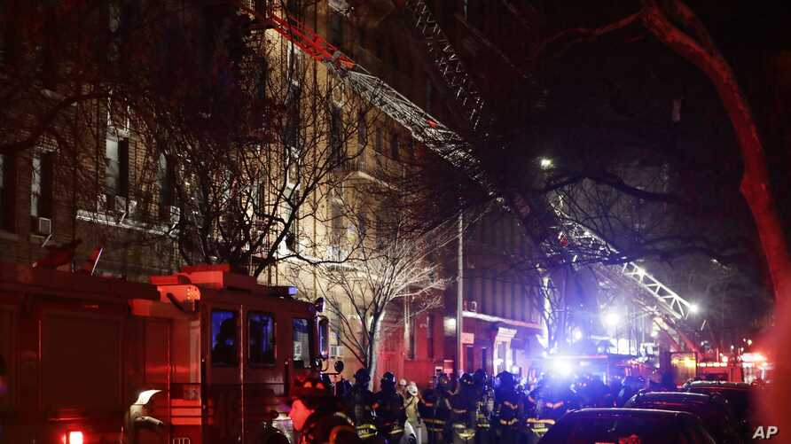 Firefighters respond to a building fire, Dec. 28, 2017, in the Bronx borough of New York. The Fire Department of New York says a blaze raging in the Bronx apartment building has left six people dead and more seriously injured.