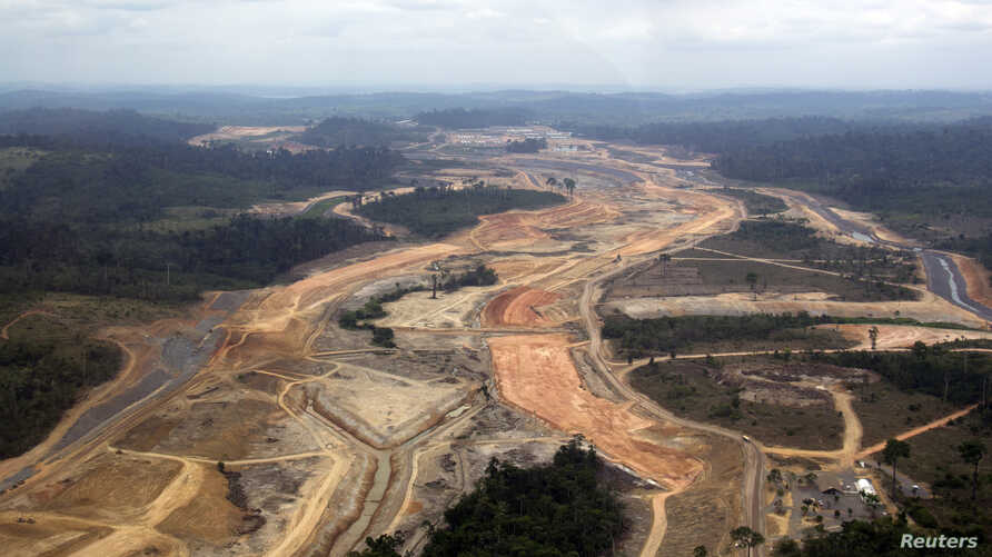An aerial photograph shows the construction site of the Belo Monte hydroelectric dam at Pimental, near Altamira in Para State, November 15, 2012. After years of gains against destruction of the Amazon rainforest, Brazil appears to be suffering from a