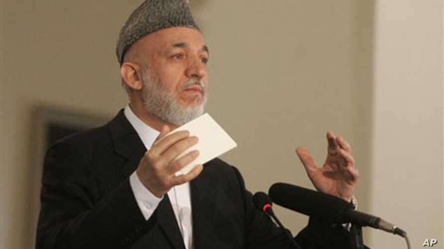 Afghan President Hamid Karzai speaks during a conference in Kabul, 20 Oct 2010