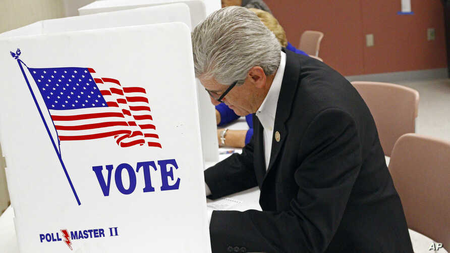 Republican Mississippi Gov. Phil Bryant casts his ballot, Nov. 3, 2015, in  downtown Jackson, Miss. Mississippi.