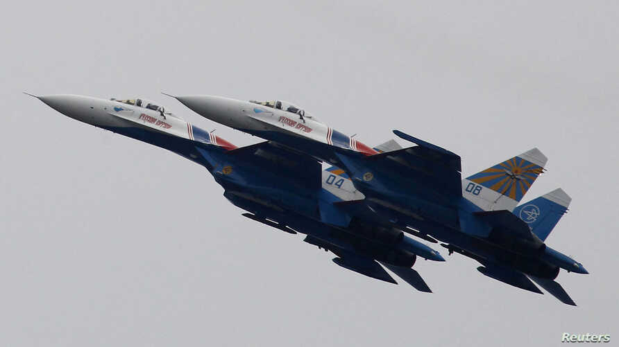 Russian Air Force Su-27 Russkiye Vityazi (Russian Knights) jet fighters at air show outside Moscow (2011 photo)