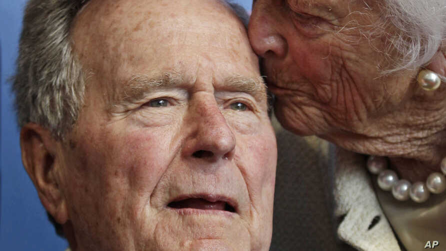Former President George H.W. Bush, and his wife former first lady Barbara Bush, arrive for the premiere of HBO's new documentary on his life near the family compound in Kennebunkport, Maine,June 12, 2012.