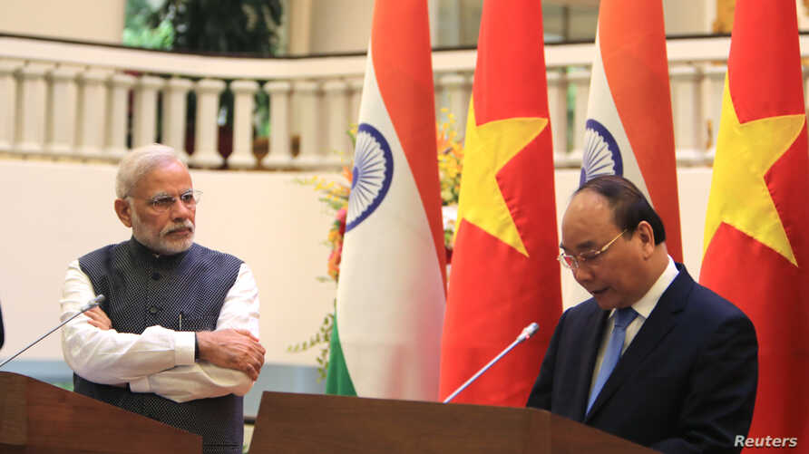"""Indian Prime Minister Narendra Modi, left, listens to Vietnamese Prime Minister Nguyen Xuan Phuc during a press conference in Hanoi, Vietnam, Sept.3, 2016. The two countries have agreed to upgrade a """"strategic partnership,"""" giving Vietnam more Indian"""