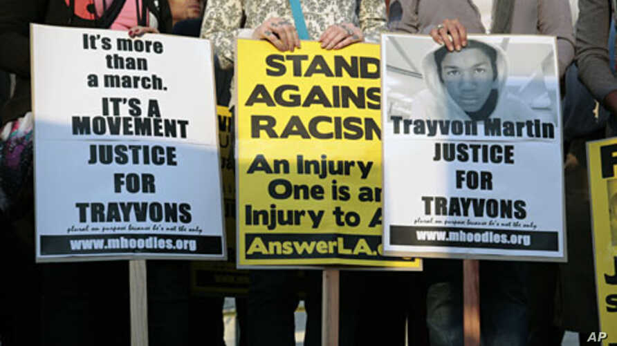 Civil rights activists and protesters gather on the steps of Los Angeles City Hall as they seek justice for 17-year-old Trayvon Martin in Los Angeles, California, April 9, 2012