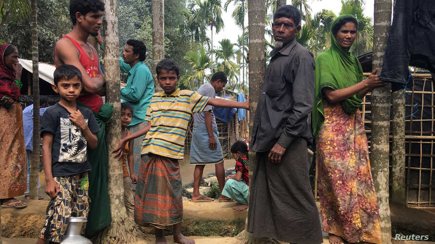 Rohingya Muslims gather outside their makeshift homes on land belonging to Bangladeshi farmer Jorina Katun near Kutapalong refugee camp in the Cox's Bazar district of Bangladesh, Feb. 9, 2018.