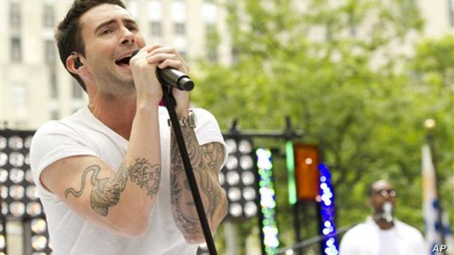 """Maroon 5 front man Adam Levine performs on NBC's """"Today"""" show on Friday, June 29, 2012 in New York. (Photo by Charles Sykes/Invision/AP)"""