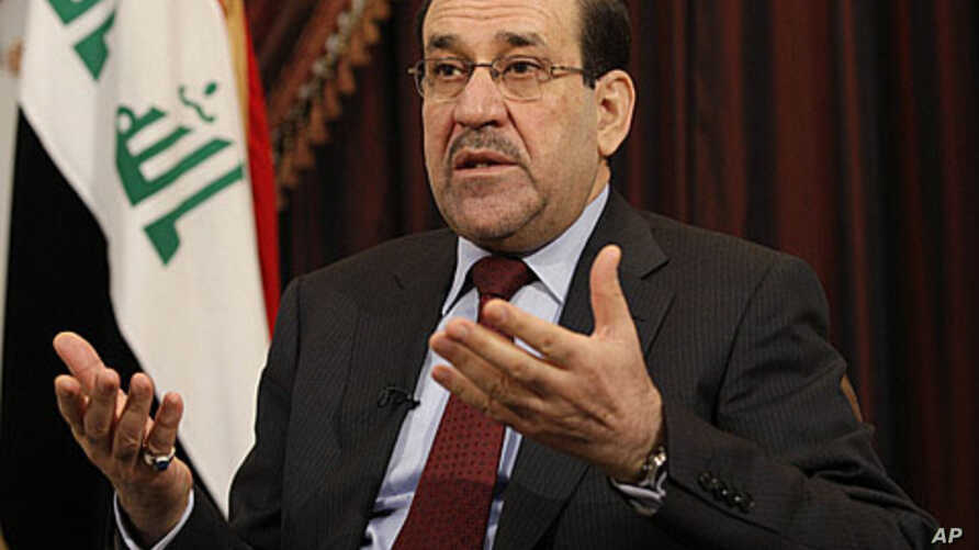 Iraq's Prime Minister Nouri al-Maliki speaks during an interview with The Associated Press in Baghdad, Iraq, Saturday, December 3, 2011.