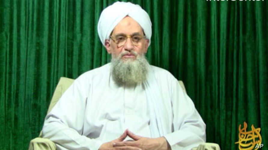 """This still image from video obtained courtesy of a group called """"IntelCenter,"""" showing Al-Qaeda leader Ayman al-Zawahiri appearing in a new video released, October 11, 2011."""