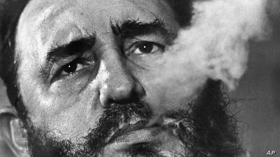 FILE - Cuban Prime Minister Fidel Castro exhales cigar smoke during an interview at his presidential palace in Havana, Cuba, March 1985. Castro, a Havana attorney who fought for the poor, overthrew dictator Fulgencio Batista's government on Jan. 1, 1...