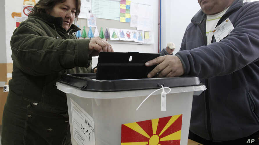 A woman casts her ballot at a polling station in Tearce, northwestern Macedonia, Sunday, Dec. 25, 2016.
