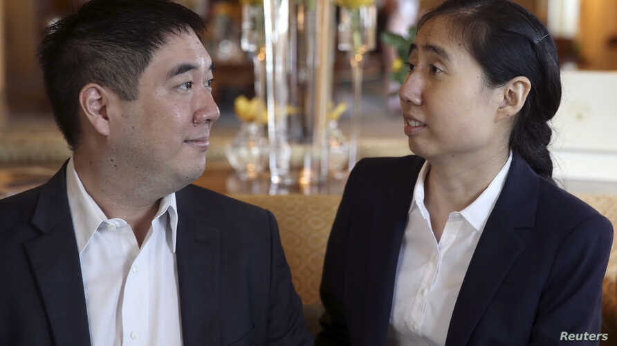 FILE - Grace and Matthew Huang wait to meet with U.S. Ambassador to Qatar Dana Shell Smith in Doha, Oct. 19, 2014.
