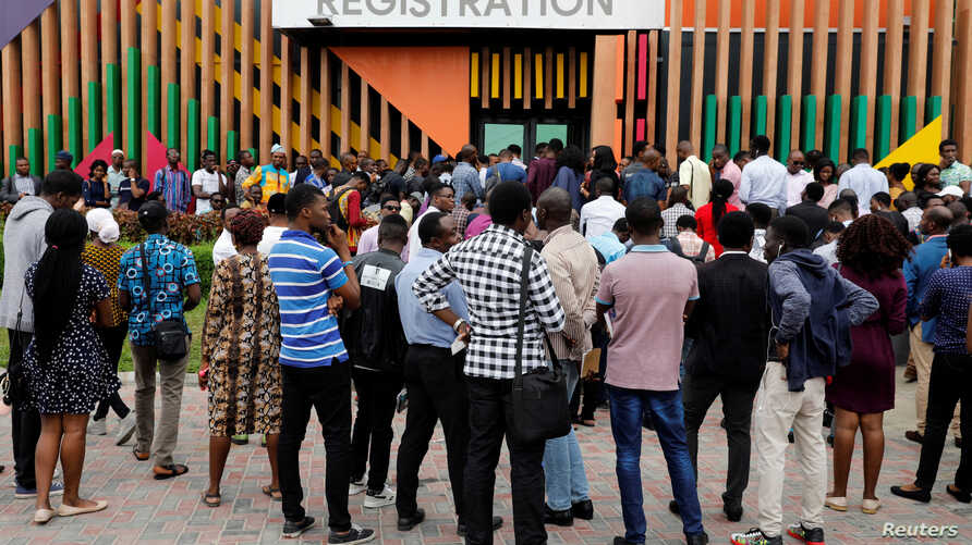 Youths are seen outside the venue of the launch of Google free wifi project in Lagos, Nigeria, July 26, 2018.