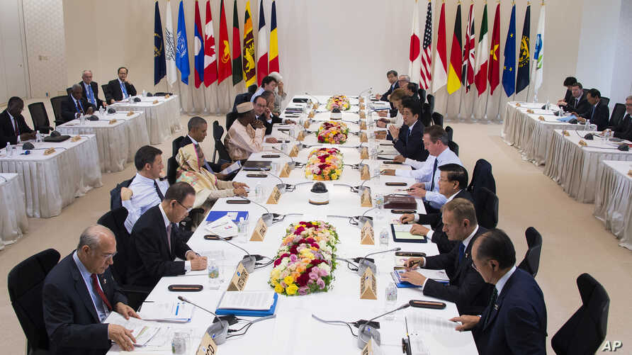 Leaders attend the the first Outreach Session during the final day of the Group of Seven summit meetings in Ise, Japan, Friday, May 27, 2016.
