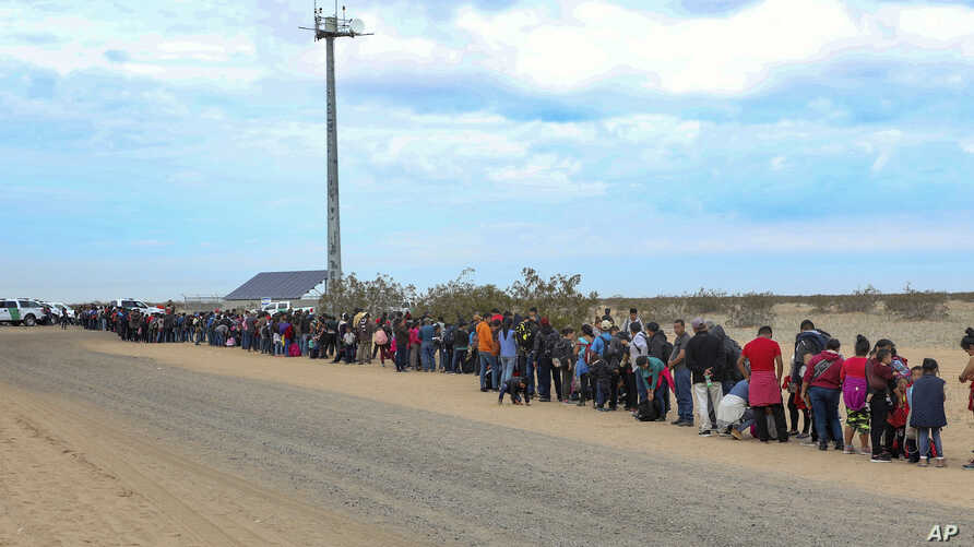 This Jan. 14, 2019, photo released by U.S. Customs and Border Protection shows some of 376 Central Americans the Border Patrol says it arrested, the vast majority of them families who had dug holes to cross into the United States, about 10 miles east