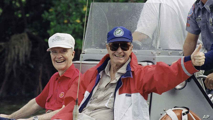 FILE - U.S. President George H. Bush gives the thumbs up as he returns from fishing in Charlotte Harbour with national security adviser Brent Scowcroft, while vacationing in Boca Grande, Florida, Nov. 12, 1992.
